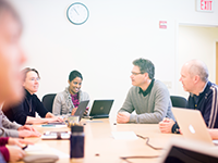 image of technology staff around conference table